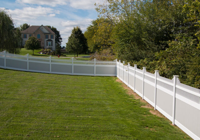 Large yard with vinyl privacy fencing installed