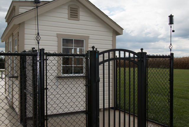 black chain link fence surrounding a commercial property