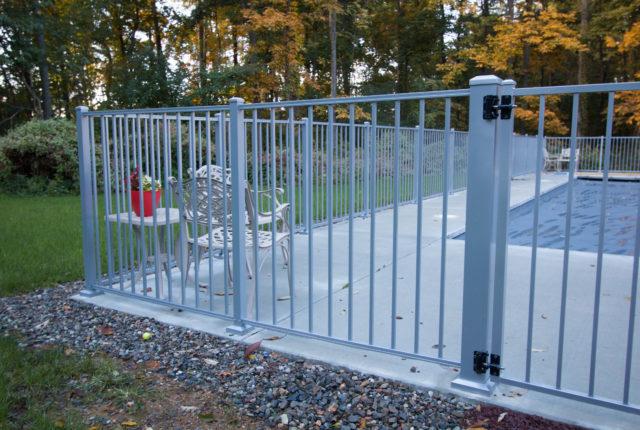 white aluminum pool fence