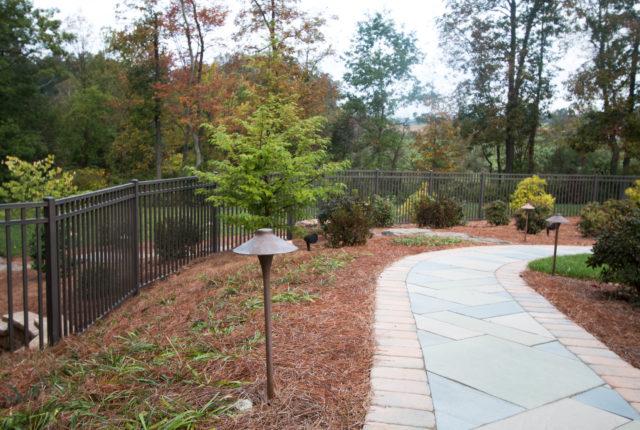 aluminum fence along a path