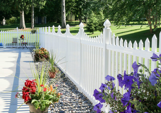 White vinyl picket fencing with landscaping in Pittsburgh, PA