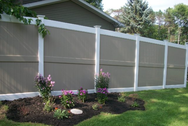 tan and white residential privacy fencing