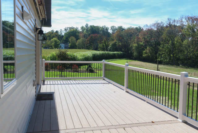 residential vinyl railing installation on a pa deck