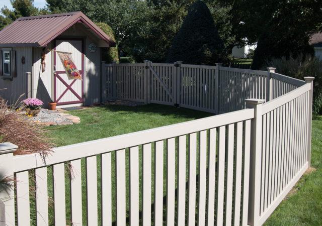 Backyard vinyl fence installation