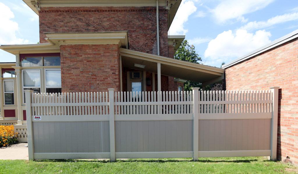 Vinyl fencing colors against brick house