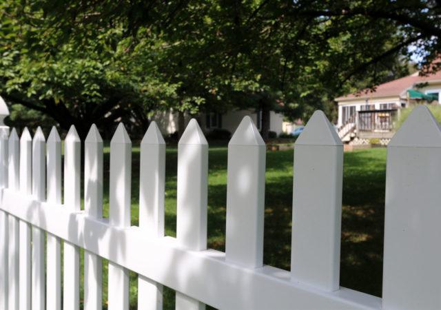 Close up of vinyl picket fencing