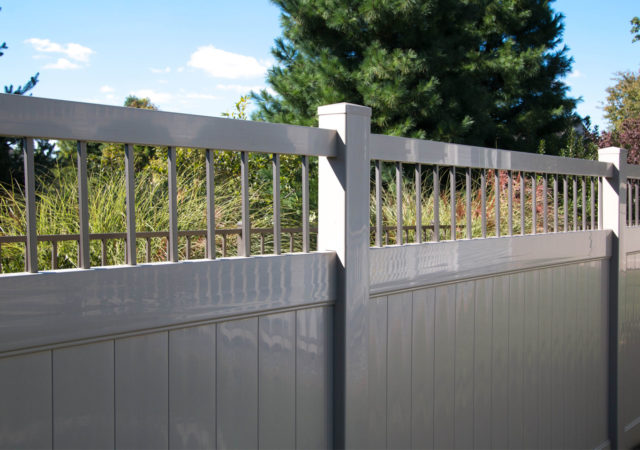 Detailed lattice top tan vinyl privacy fence