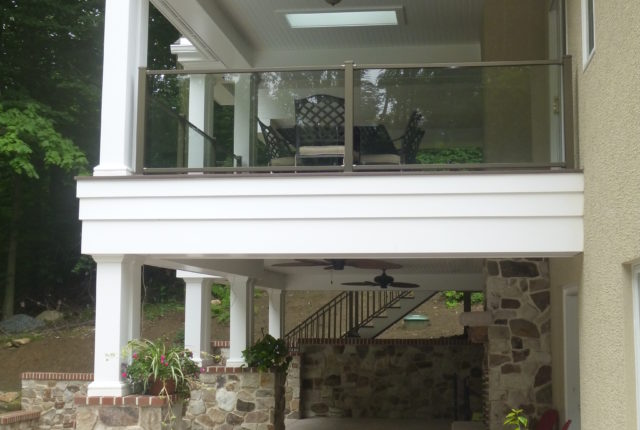 white aluminum and glass railing