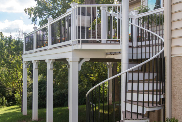 white vinyl handrail around residential deck and staircase