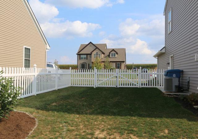 vinyl fence surrounding new construction