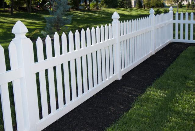 traditional white vinyl picket fence