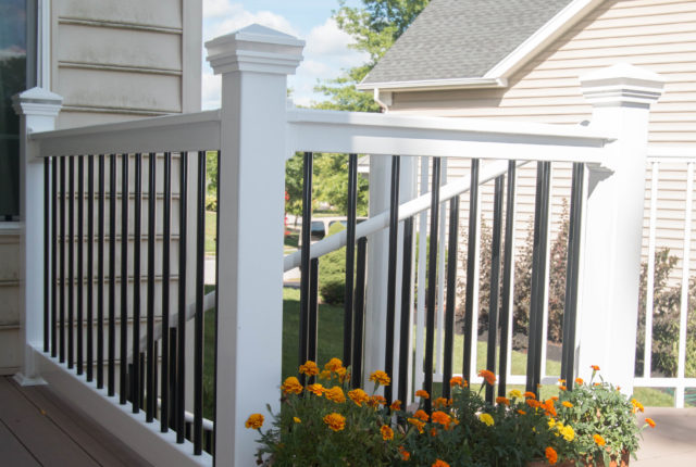 white vinyl railing with decorative post caps