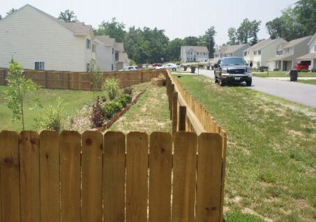 Wooden fence for privacy from road