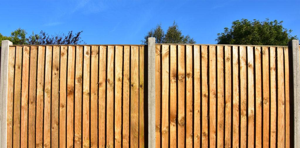 Wooden dog fence in backyard