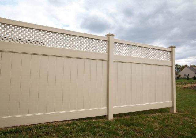 Tan privacy vinyl fence with lattice top