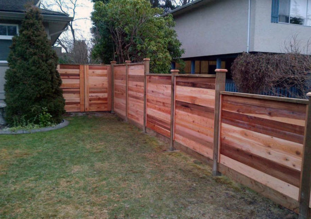 Staggered levels wood fence