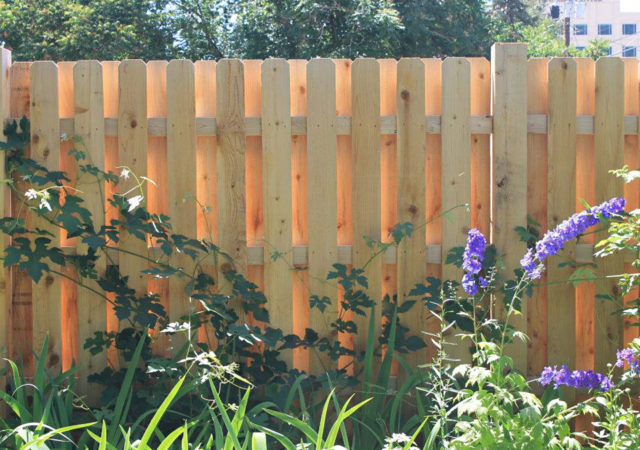 Shadowbox wooden privacy fence for backyard
