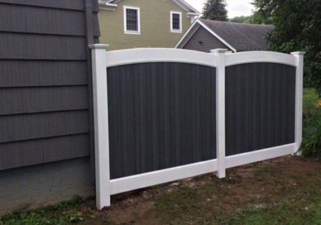 Black vinyl fence with black house siding