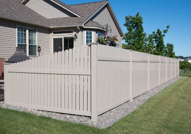 Tan house with matching tan vinyl fence