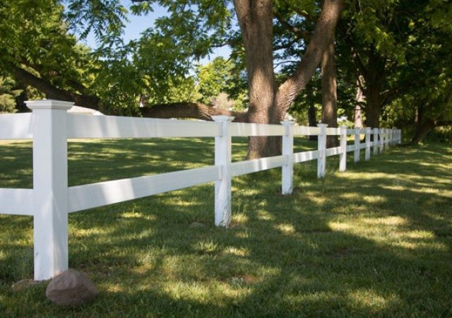 House with split rail white vinyl fence