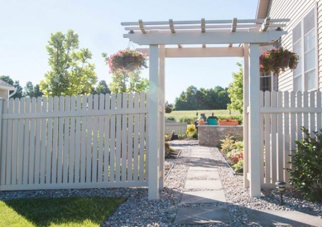 White vinyl fence with arbor