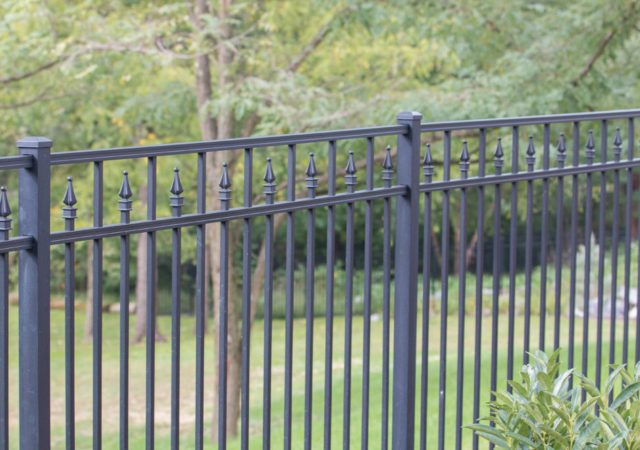 Clay colored aluminum fence shared between neighbors
