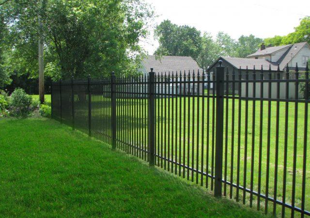 Neighbors sharing an aluminum security fence