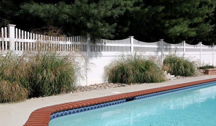 White vinyl privacy pool fence up to code