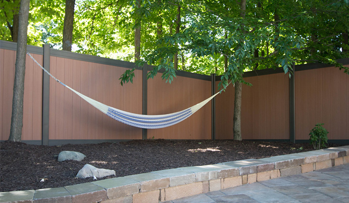 luxury backyard fence with hammock