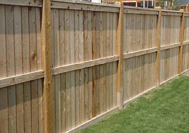 Tall wooden fence for backyard security