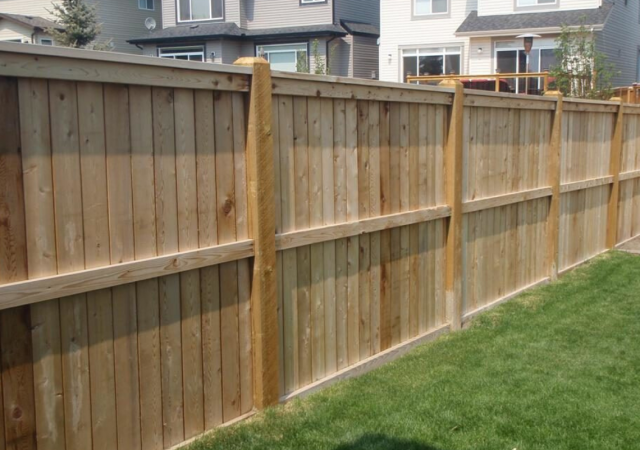 Secured yard with beautiful wood privacy fence style
