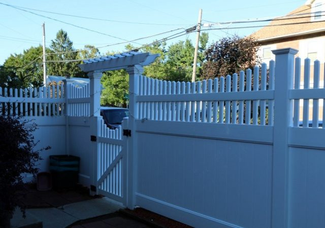Franklin vinyl privacy fence with arbor