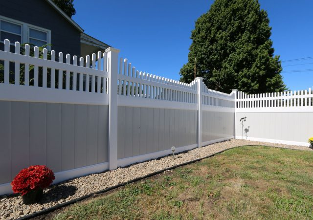 tan and white vinyl privacy fence