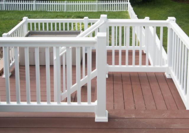 Deck with white vinyl railing