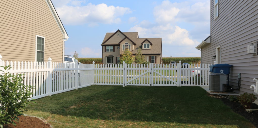 vinyl fenced yard for home with dogs