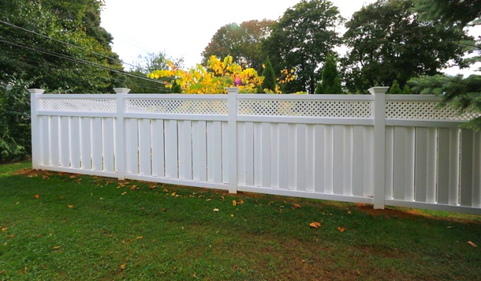Trendy white privacy fence in backyard PA