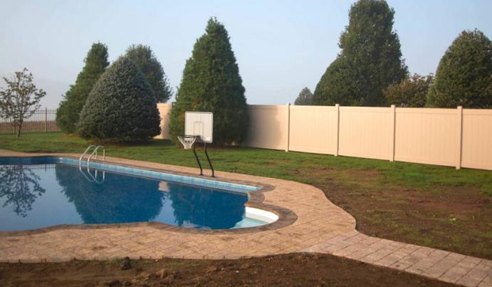 Tan vinyl poolside fence