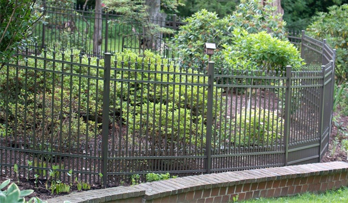 Backyard landscaping with aluminum fence