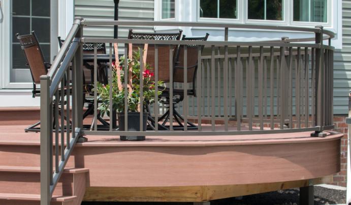 Dark aluminum deck railing on composite deck