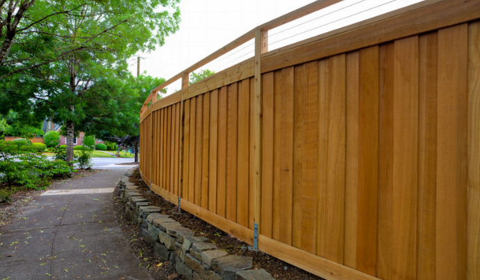 Contemporary wood privacy fence around property