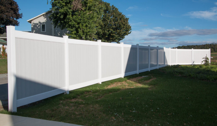Light gray and white backyard privacy fence