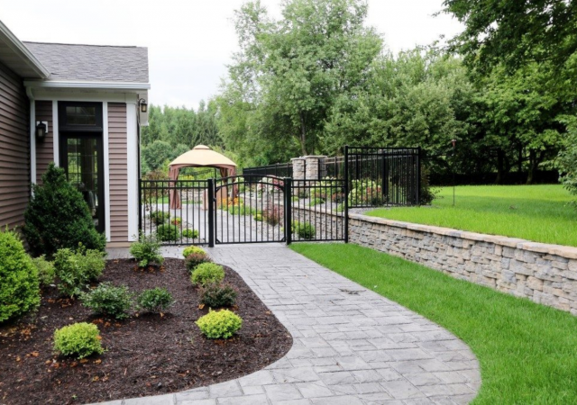 Landscaped patio with durable aluminum fence