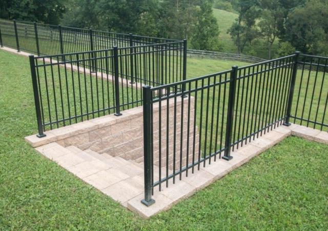 Aluminum fence with backyard steps